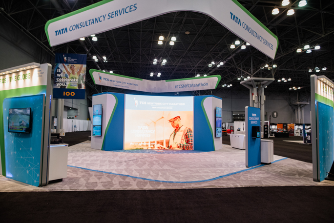 expo booth with a large screen