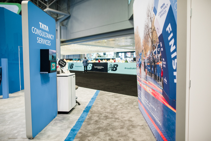 blue expo booth and a white stand