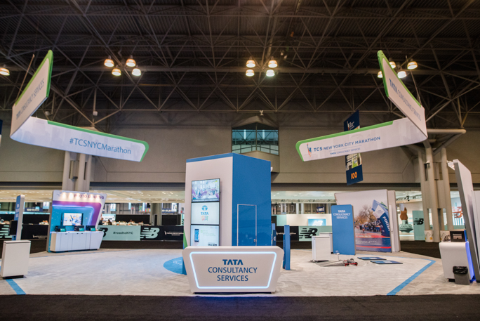 blue expo booth with three screens