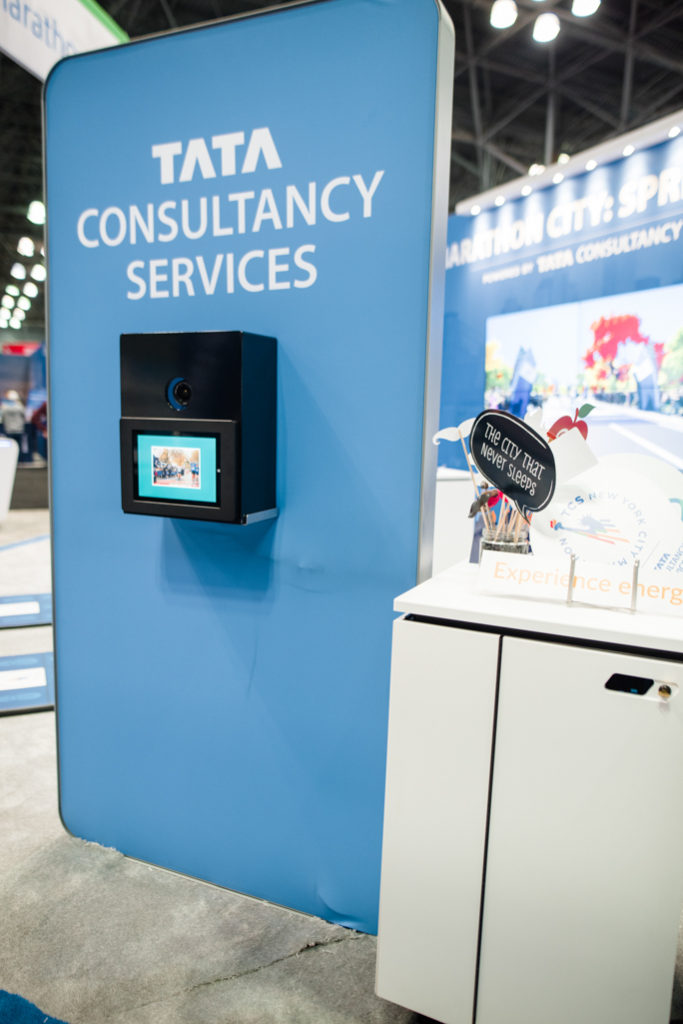 photo booth with a tablet on blue stand