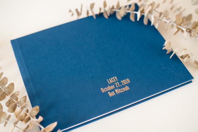 A navy photo album and eucalyptus