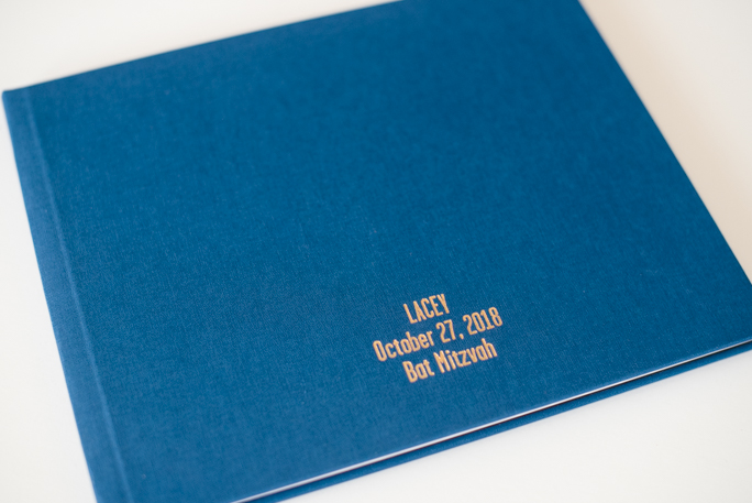 A navy photo album with gold foil printing