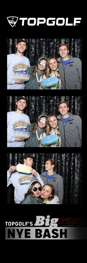Photo strip with 4 people posing and holding signs