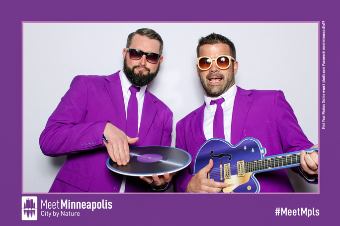 Two men wearing purple and sunglasses
