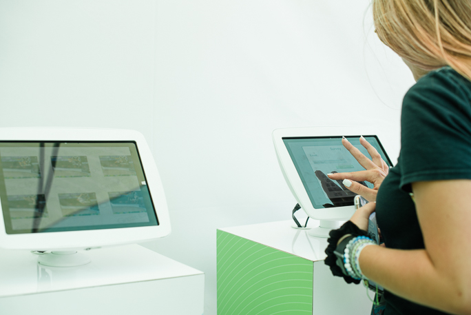 A person entering information into a tablet