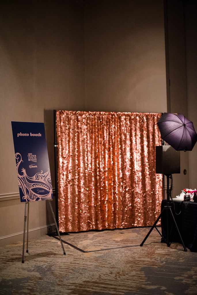 Photo backdrop and a sign next to a photo stand