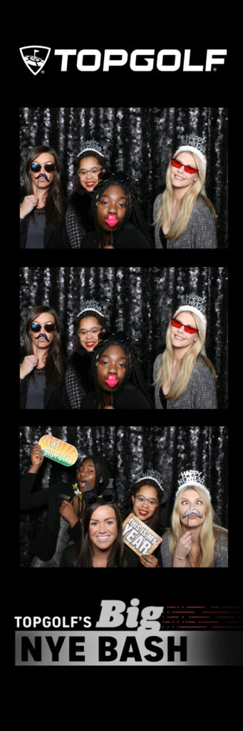 Photo strip with 4 people posing for a photo