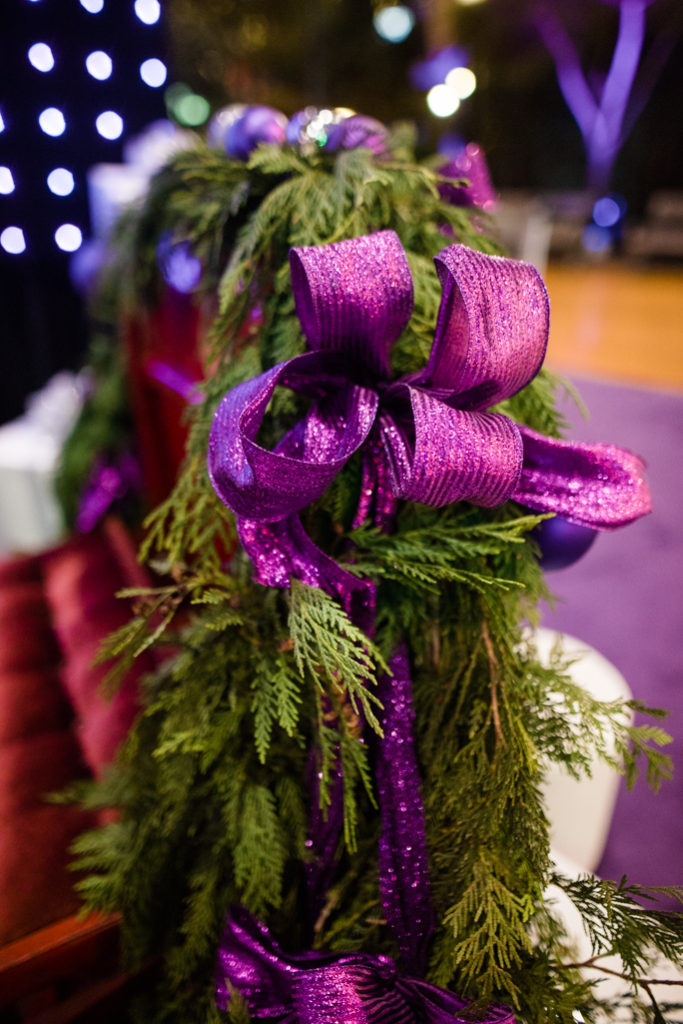 Christmas tree branch with a purple ribbon