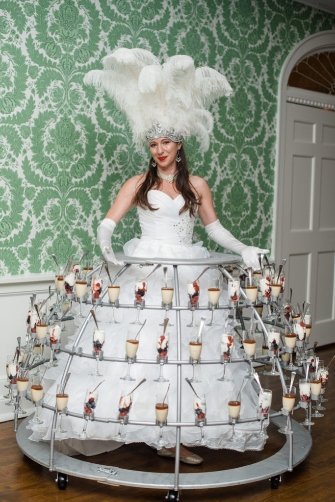 A person in a skirt with desserts