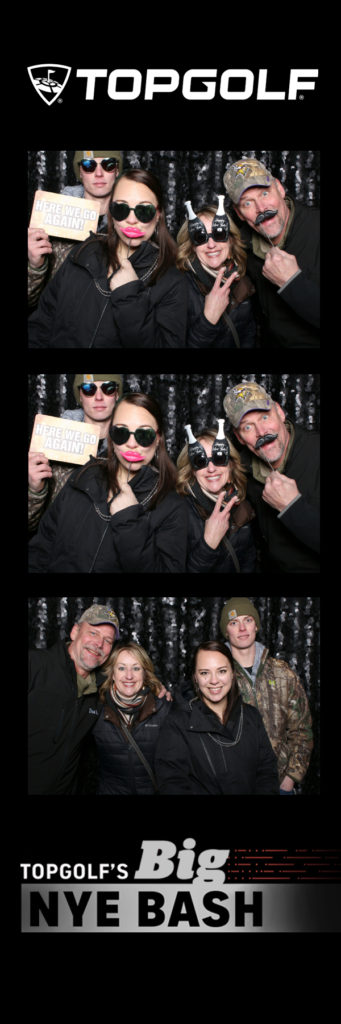 Photo strip with 4 people posing in glasses and holding signs