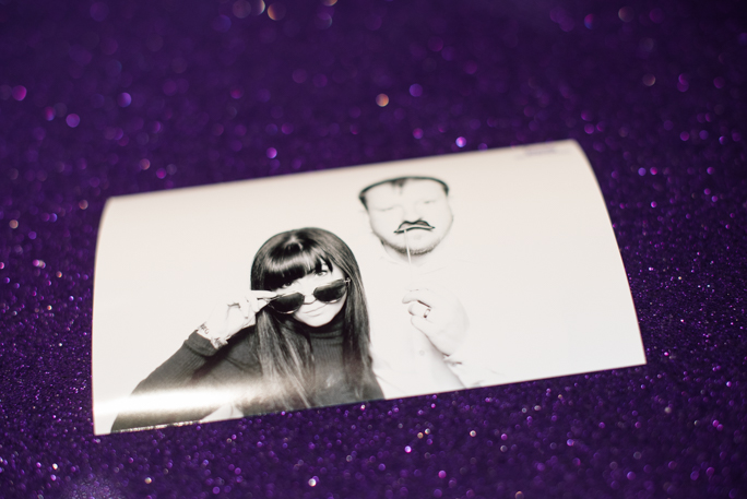 A black and white photo on a purple surface