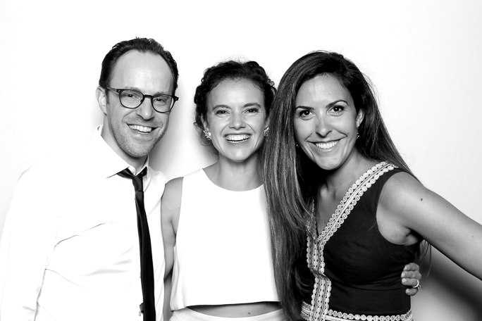 Three people smiling for a photo