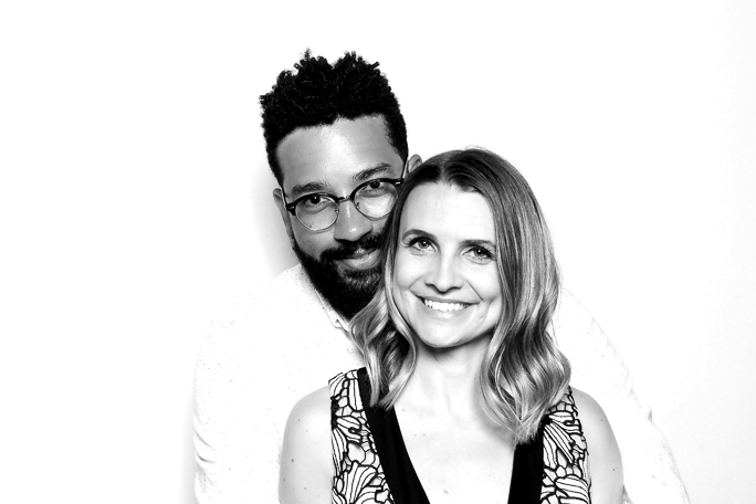 A couple smiling for a black and white photo