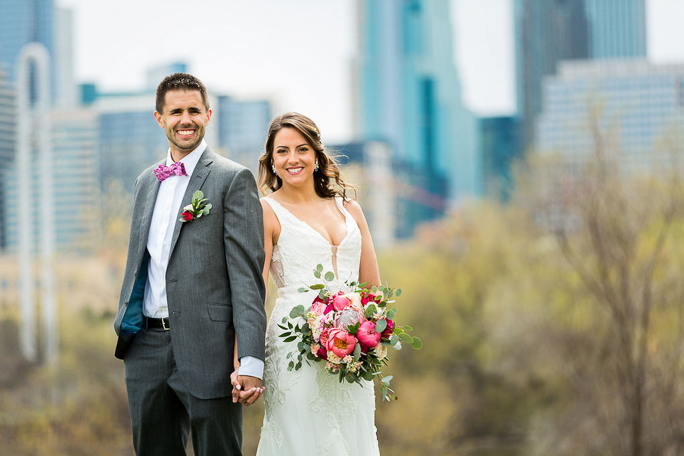 A bride and groom smiling