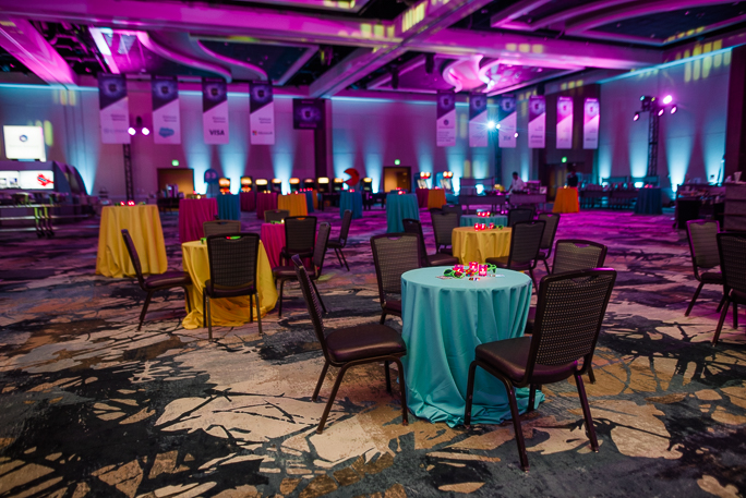Decorated room with tables with colorful tablecloths