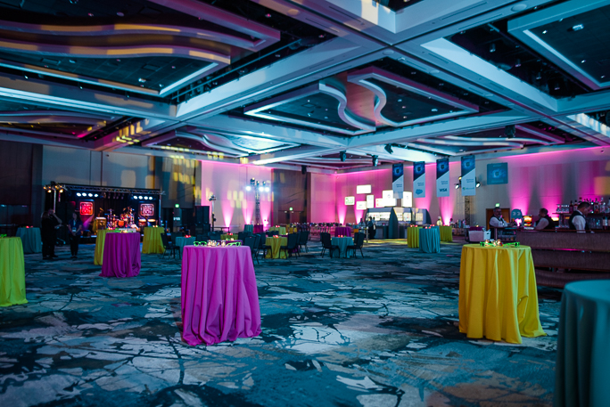 Decorated room with tables with colorful tablecloth