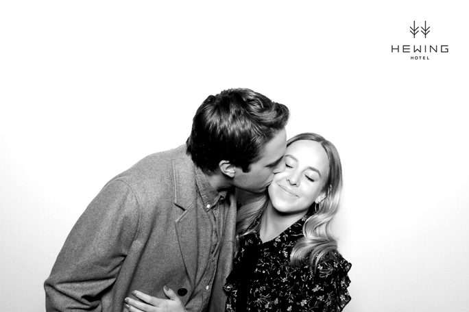 Man kissing women on a cheek